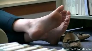 Beautiful student girl feet in library