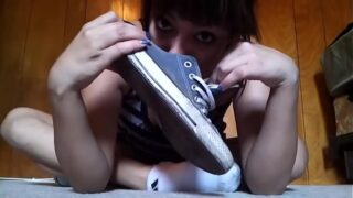Beautiful teen takes off her shoes and socks with sniffing it to show her feet