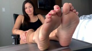 Beautiful woman shows her soles