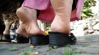 Candid arab feet in a park