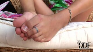 Sexy girl with sandals love to tease with her feet